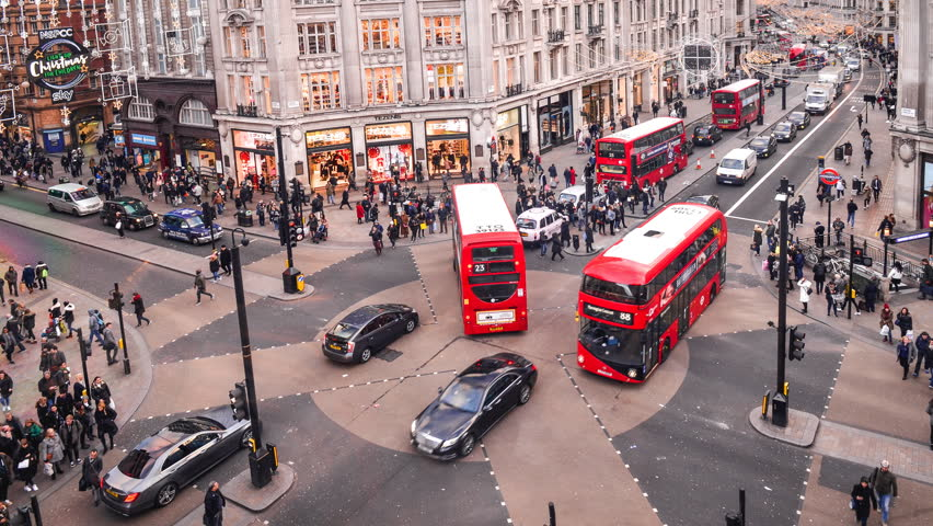 LONDON- NOVEMBER, 2017: Timelapse of busy Oxford Circus, an iconic London landmark where Oxford Road and Regent Street shopping areas meet.