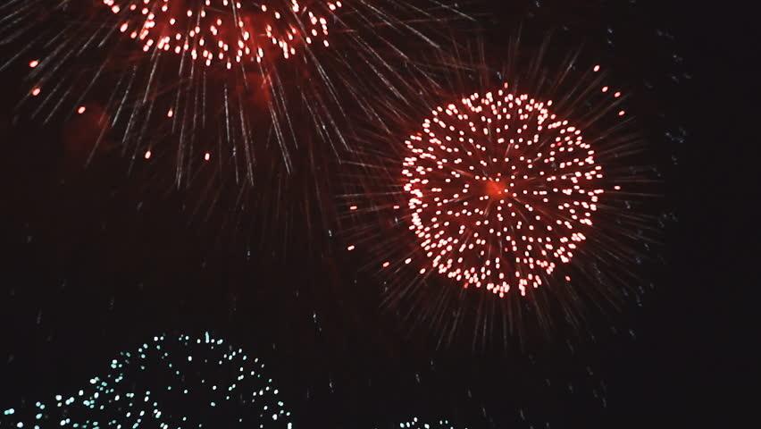 Explosions of beautiful fireworks in night sky | Shutterstock HD Video #33424744
