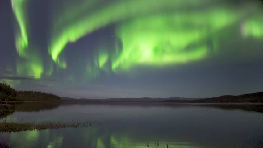Real time (not a timelapse) strong green and pink aurora borealis (northern lights) dancing over lake in Alaska with realistic movement   Shutterstock HD Video #33431059