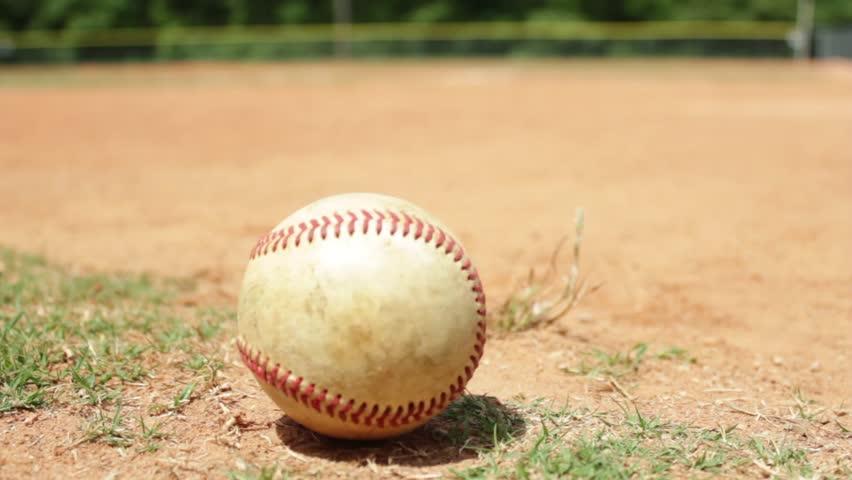 Close up shot of a baseball on a baseball diamond