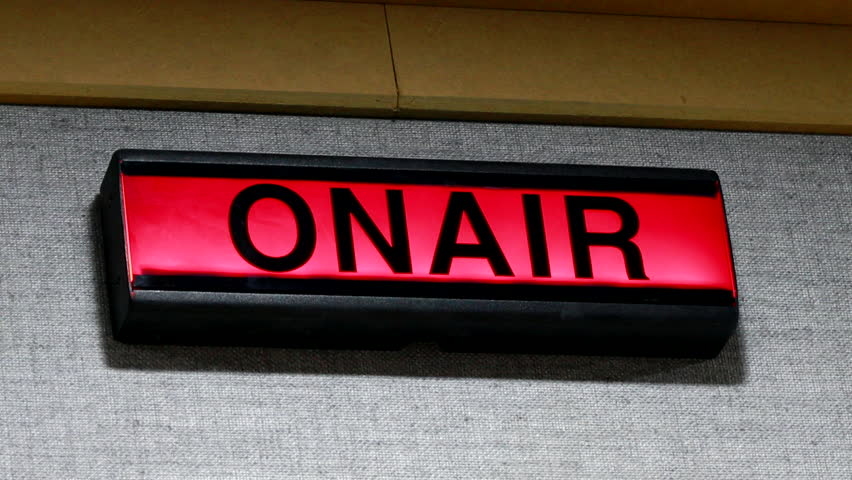ON AIR sign being turned on and off on wall of studio