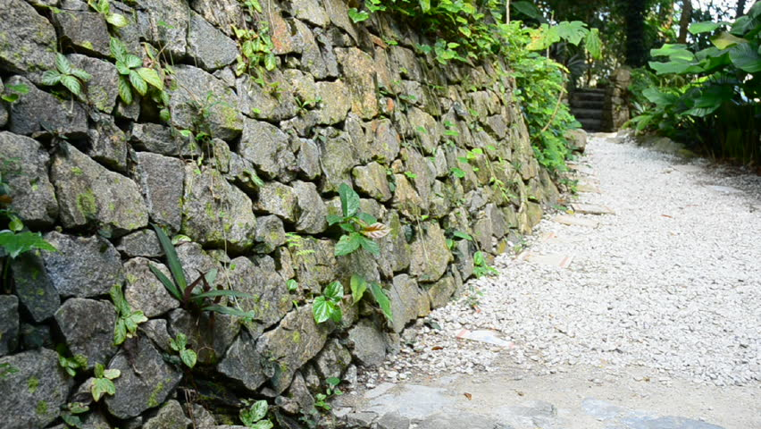 Man made rock wall pathway lead to forest | Shutterstock HD Video #3344783