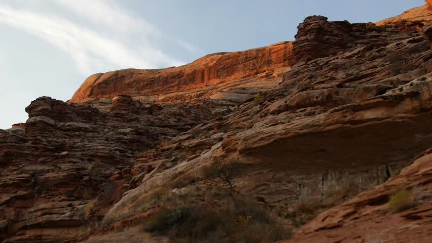 Red rocks float past as the sunrise shines on the Green River. | Shutterstock HD Video #33460507
