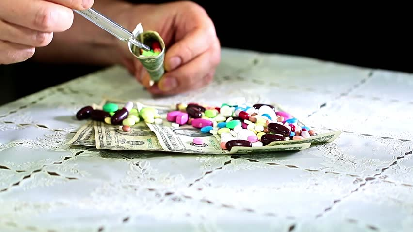 Medicines and paper denominations American dollars as doctor's tools | Shutterstock HD Video #33467770
