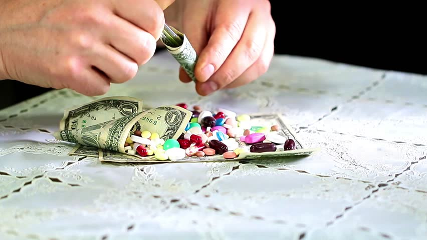 Medicines and paper denominations American dollars as doctor's tools | Shutterstock HD Video #33467779