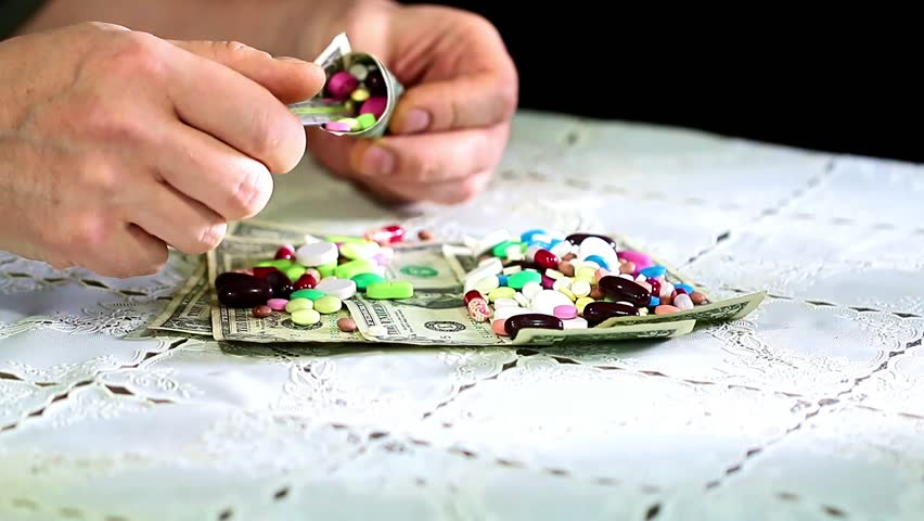 Medicines and paper denominations American dollars as doctor's tools | Shutterstock HD Video #33467782