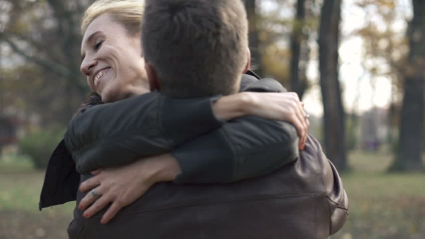 Happy couple hugging in the park, slow motion, shot at 240fps