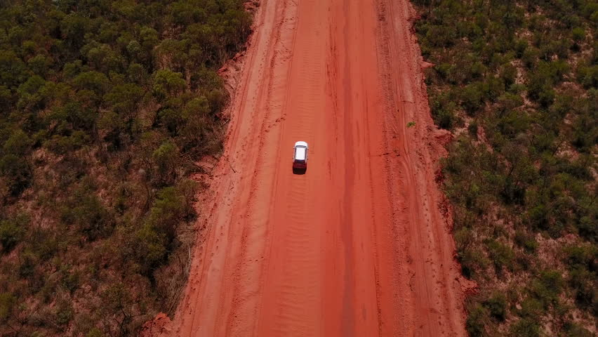 4WD car driving on dirt road in Australia's outback