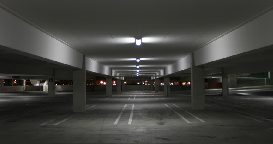 Empty and quiet car parking garage alone in the evening