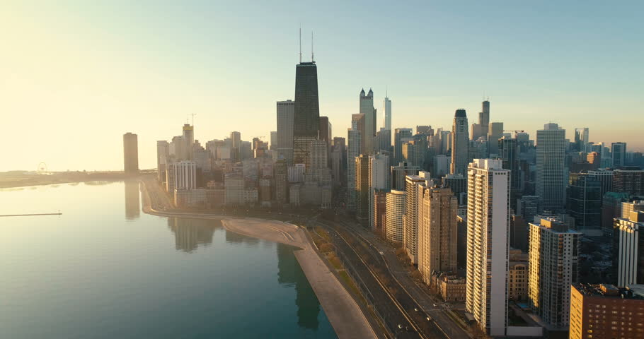 Aerial shot of Chicago Downtown skyline at sunrise. Buildings by the lake with road and cars   Shutterstock HD Video #33539863