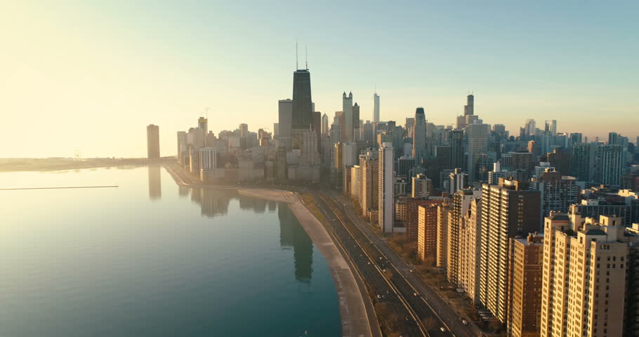 Aerial shot of Chicago Downtown skyline at sunrise. Buildings by the lake shore with road and cars   Shutterstock HD Video #33539878