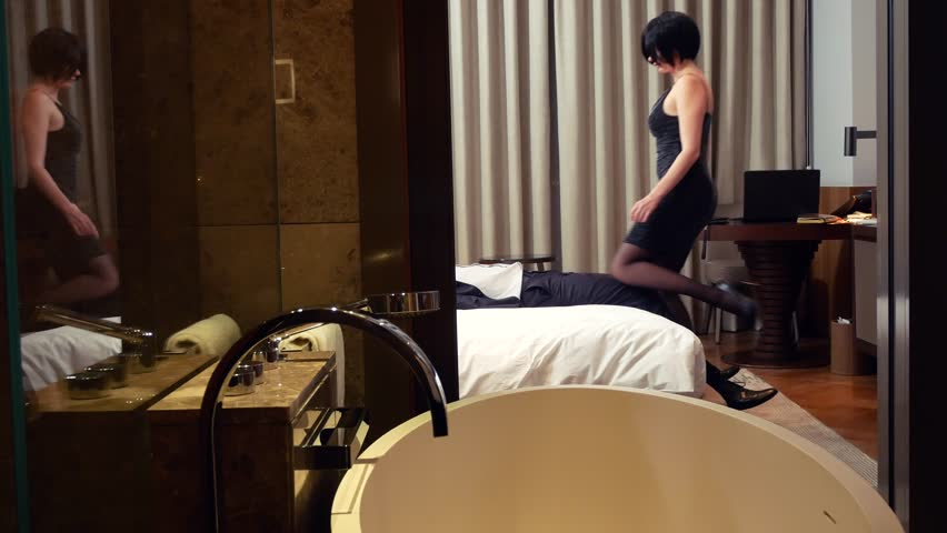 The concept of prostitution, industrial espionage. The brunette makes the businessman drunk and steals information from his laptop in the hotel room. 4k | Shutterstock HD Video #33540742