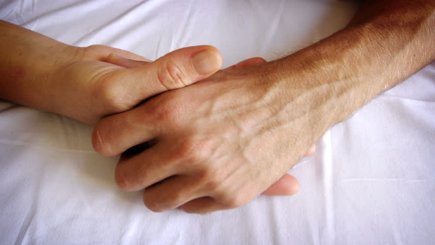 a male and female caressing each other's hands