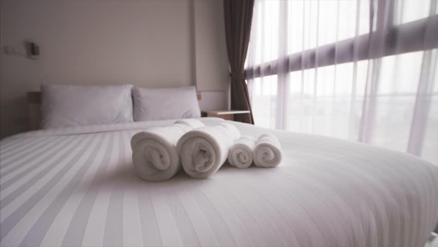 Living room interior, bed with a set of towels. Closeup.