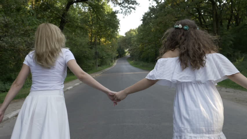 Freedom concept with girl friends running on a forest country road | Shutterstock HD Video #33578749