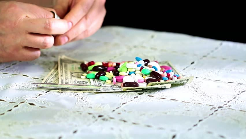 Medicines and paper denominations American dollars as doctor's tools | Shutterstock HD Video #33581563