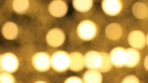 Abstract background Yellow bokeh light from the Christmas tree.lights would suit a Christmas theme