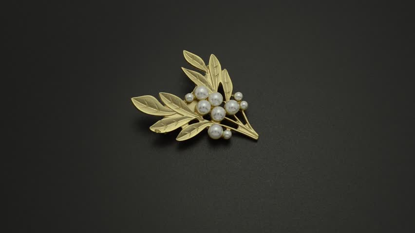Golden brooch twig with pearls isolated on black | Shutterstock HD Video #33613450