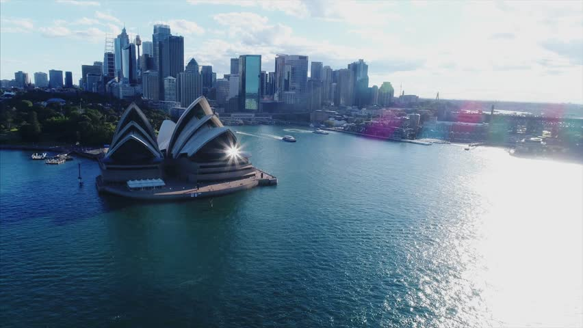 The Sydney Opera House is a multi-venue performing arts centre in Sydney, New South Wales, Australia. It is one of the 20th century's most famous and distinctive buildings. (Aerial/Drone)