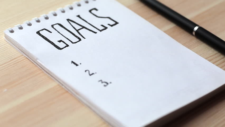Goals concept. Notebook with goals list on wooden table. Motivation strategy write idea success solution concept. Royalty-Free Stock Footage #33618103