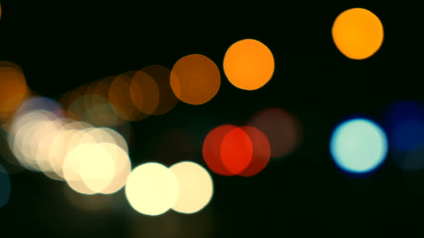 Defocused lights Los Angeles street abstract . City blur background. Moving bokeh circles of night traffic.