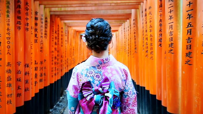 Asian women in traditional japanese kimonos walking at Fushimi Inari Shrine in Kyoto, Japan. | Shutterstock HD Video #33639808