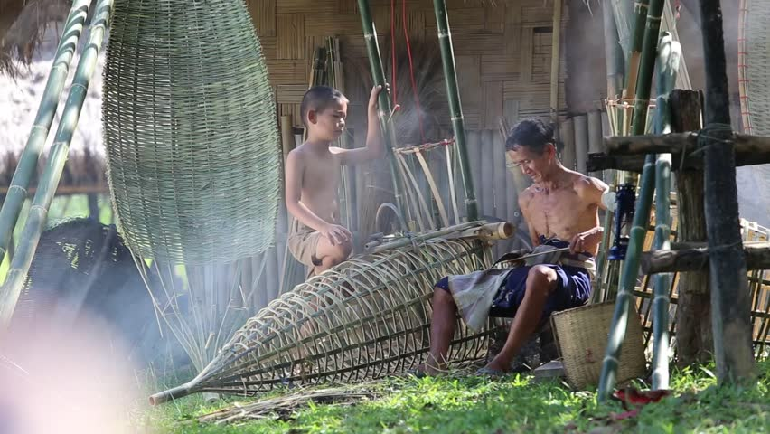 Thailand Father and son are working hand made Basket bamboo or fishing gear.