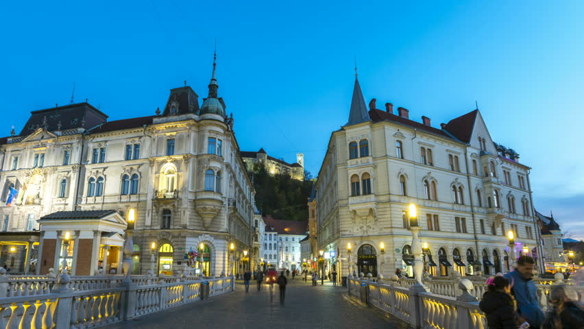 Ljubljana City Centre at night, hyperlapse timelapse video. Preseren Square,Triple Bridge and view of Castle at night from Bridge, Slovenia. Royalty-Free Stock Footage #33661033