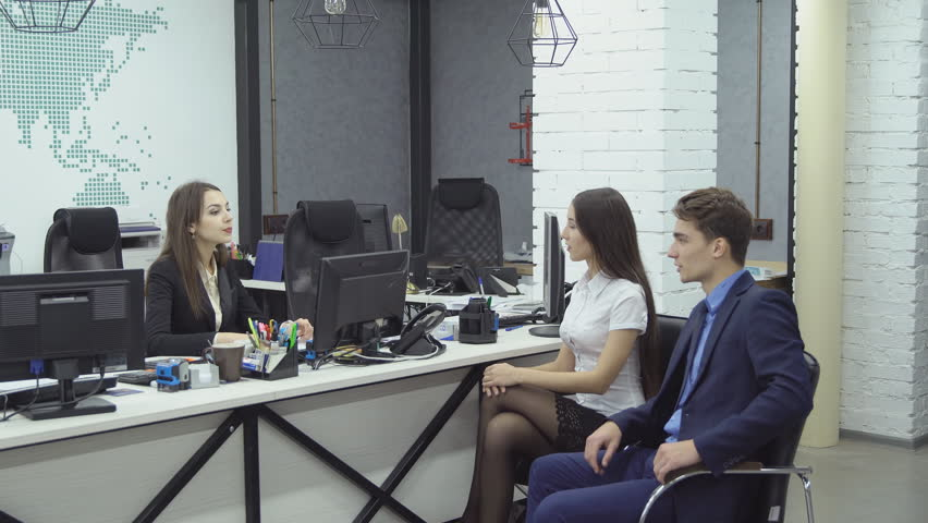 Couple of managers - young woman and man in formal attire report something to their boss woman during working day at the office #33667777
