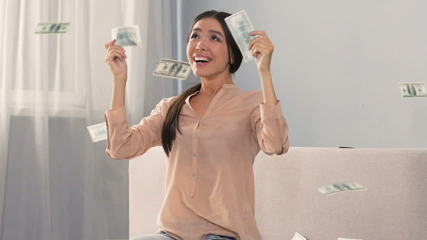 Asian lady rejoicing at unexpected news that she inheriting fortune, slow-mo | Shutterstock HD Video #33677389