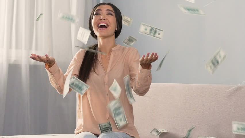 Money falling on happy shopaholic woman enjoying cash back service, slow motion | Shutterstock HD Video #33677392