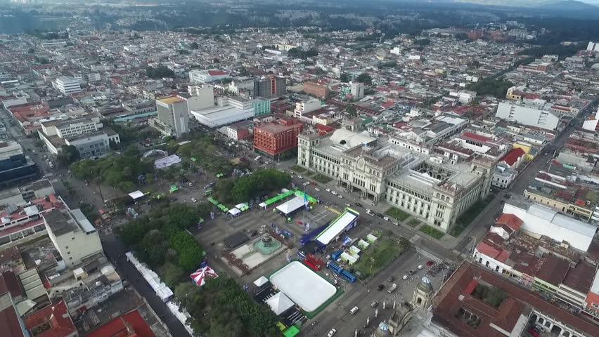 GUATEMALA - NOVEMBER 21, 2017: Cityscape of Guatemala with Santa Iglesia Catedral and National Palace of Culture. Guatemala Downtown.
