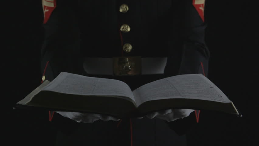 Marine in dress blues holding Bible in hands. Solider of truth holding the word of God in his hands. Combat for truth and freedom.     Shutterstock HD Video #3369056