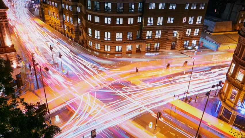 Wide angle aerial view of traffic trails on a busy juncture in London, England, UK