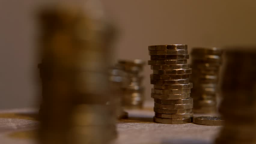 Wealth And Investment Savings Represented By Growing Coins Stacks Time-Lapse. Royalty-Free Stock Footage #33693733