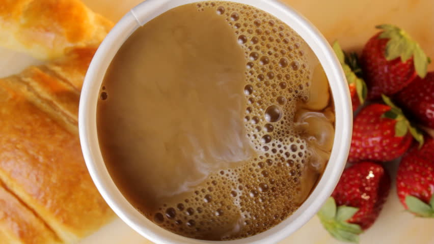 Pouring a cup of coffee at breakfast