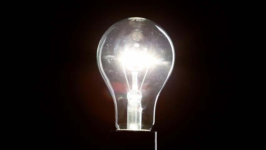 Light bulb on black background | Shutterstock HD Video #3371102