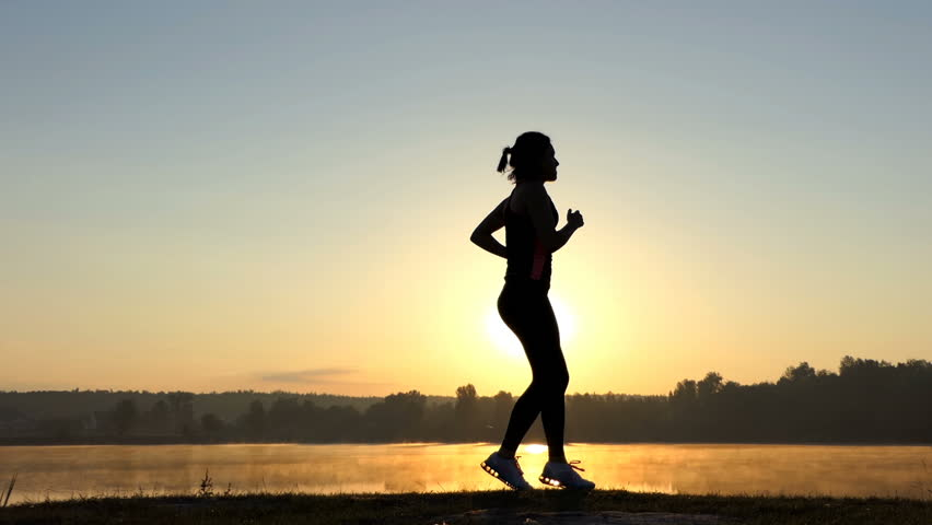 Slim woman runs back and jumps forward at sunset | Shutterstock HD Video #33715021