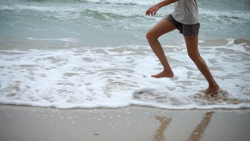 Woman runing on sand beach in Slow motion. | Shutterstock HD Video #33733024