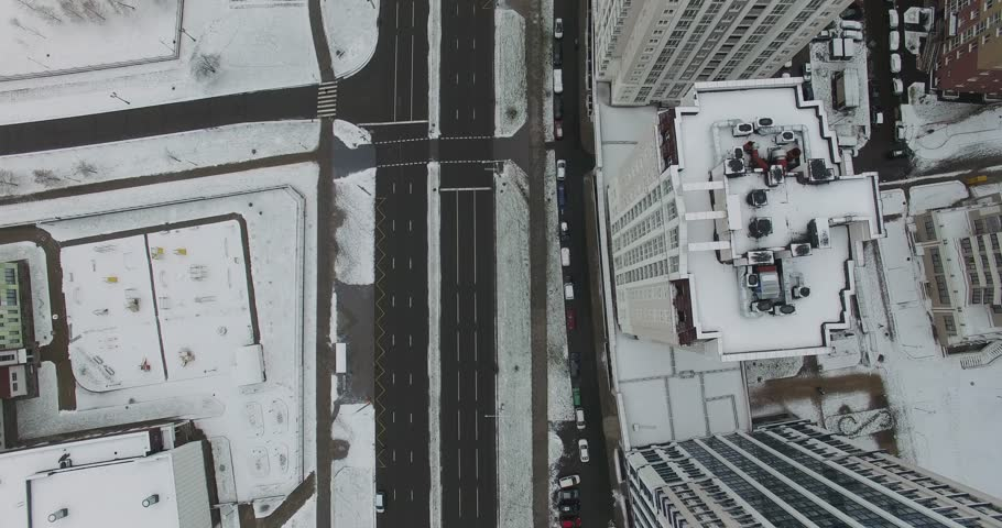 Winter. Aerial view, residential buildings, snow-covered residential area, view from height, traffic on the road.  | Shutterstock HD Video #33743860