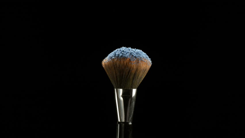 Makeup falling off a makeup brush in slow motion | Shutterstock HD Video #33751402