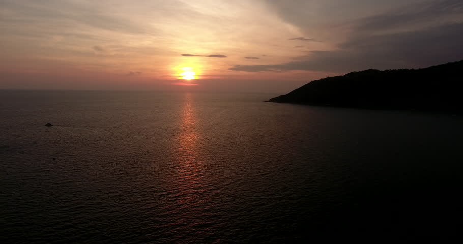 Panoramic view shooting from flying drone of endless calmness ocean with sunset on horizon.Bird's eye footage of sea surface and tropical island in Asia | Shutterstock HD Video #33760933