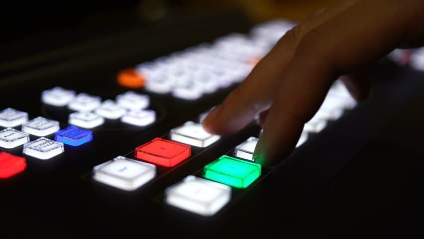 Close-up The hand presses the buttons on the broadcast mixer. | Shutterstock HD Video #33764992