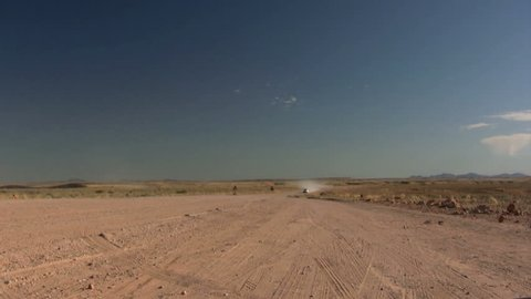 SUV driving through the Kalaharie Desert of Namibia, Africa