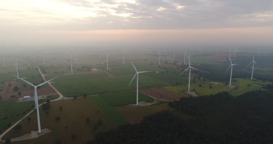 4K Aerial view of Wind turbines farm in the green field, One of the cleanest, renewable electric energy source.Future sustainable power. | Shutterstock HD Video #33811201