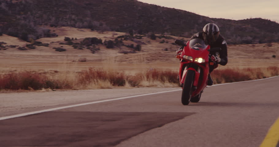 Slow Motion Extreme Motorcyclist Riding Sport Bike On Rural Country Road | Shutterstock HD Video #33814927