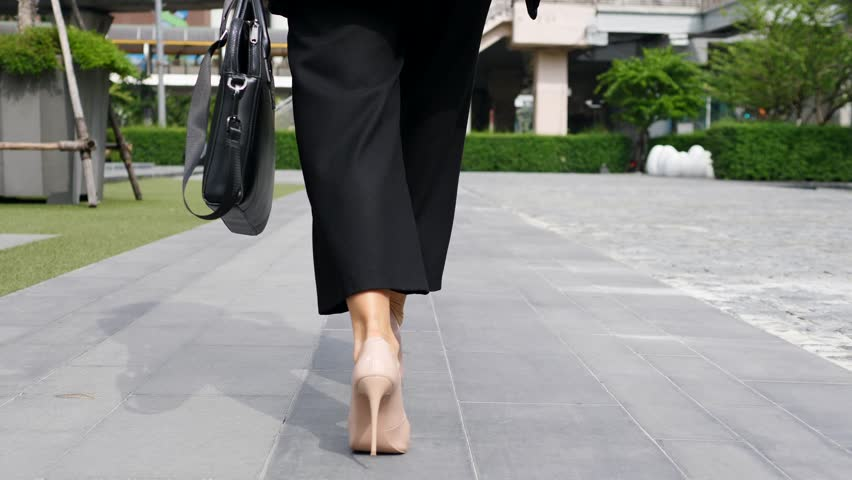 Business Woman Legs In High-Heeled Shoes Walking With Briefcase. Closeup. Slow Motion. 4K.  | Shutterstock HD Video #33816145
