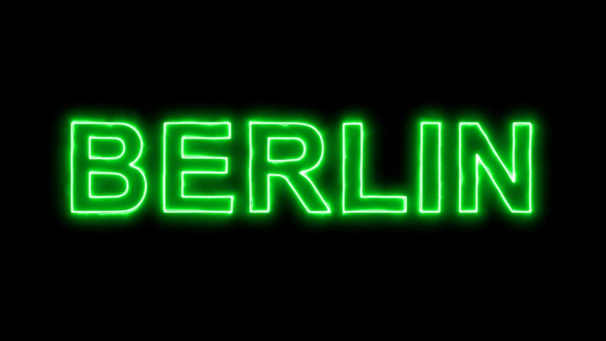 Neon flickering green capital name BERLIN in the haze. Alpha channel Premultiplied - Matted with color black | Shutterstock HD Video #33820072