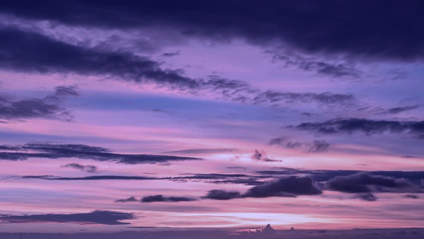 Dark purple clouds day to night sky time lapse. Purple black pass fly background.Video footage purple big building mass in horizon. Summer sunny lightness day, clean horizon, panoramic view after rain
