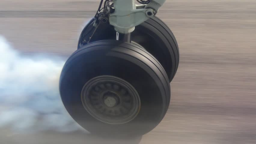View on airplane wheel at landing, close up shot